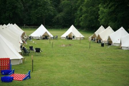 Tipi tents in a field.