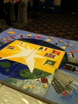 A mosaic picture featuring the earth and flags.