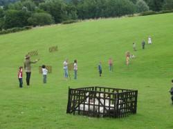 Children participate in duck herding on a family fun day.