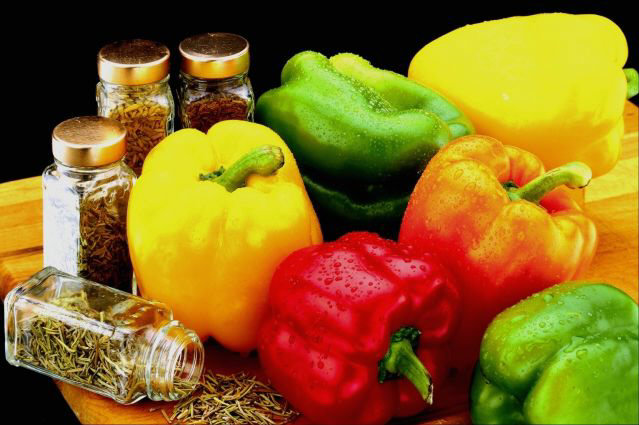 Bell peppers and spice in jars.